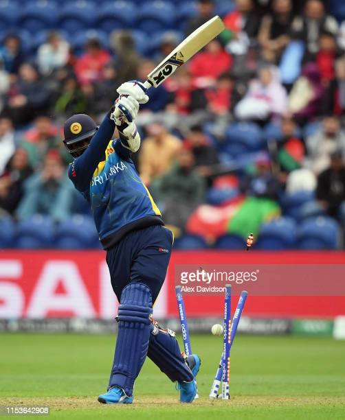 Isuru Udana of Sri Lanka is bowled by Dawlat Zadran of Afghanistan during the Group Stage match of the ICC Cricket World Cup 2019 between Afghanistan...