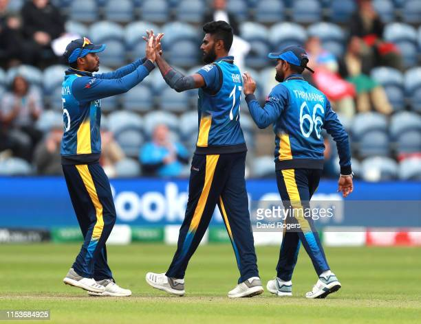 Isuru Udana of Sri Lanka is congratulated by team mates after taking the wicket of Rahmat Shah during the Group Stage match of the ICC Cricket World...