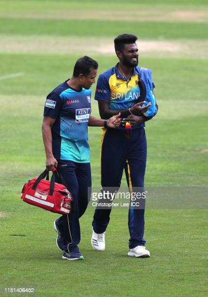 Isuru Udana of Sri Lanka leaves the field with an injury during the ICC Cricket World Cup 2019 Warm Up match between Sri Lanka and South Africa at...
