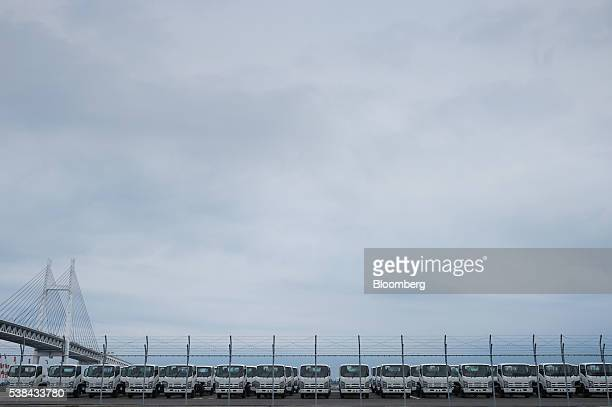 Isuzu Motors Ltd trucks bound for shipment sit at a port in Yokohama Japan on Monday June 6 2016 Japan's revised gross domestic product for the first...