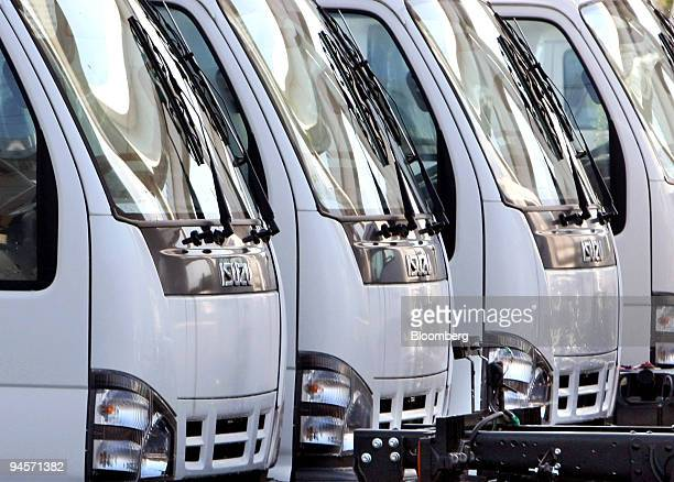 Isuzu Motors Ltd trucks wait for shipment at a car pool in Yokohama City Japan on Monday Nov 12 2007 Isuzu Motors Ltd Japan's biggest maker of light...