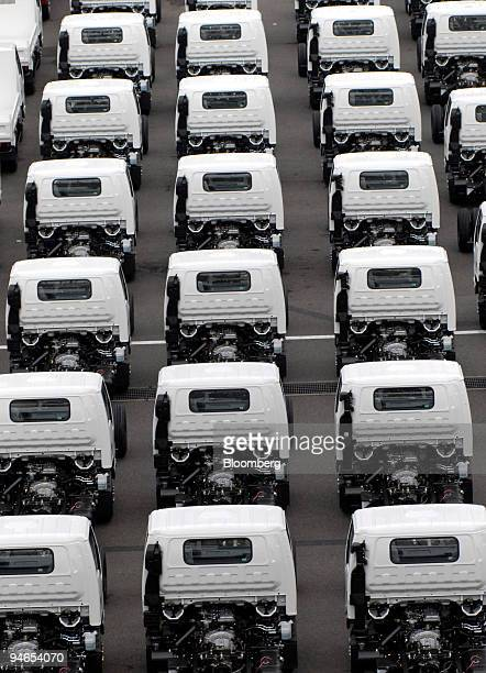 Isuzu trucks intended for export wait at a car pool in Yokohama Bay Japan on Sunday 23 July 2006 The Development Bank of Japan and 11 other companies...