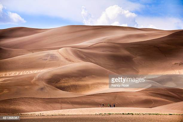 it a long way to the top! - great sand dunes national park stock pictures, royalty-free photos & images