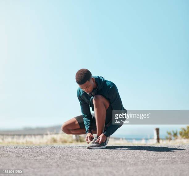 it all started with tied shoelaces and the first step - black shoe stock pictures, royalty-free photos & images