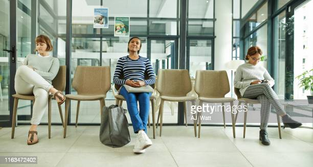 it doesn't feel like a wait with complementary wifi - waiting room stock pictures, royalty-free photos & images