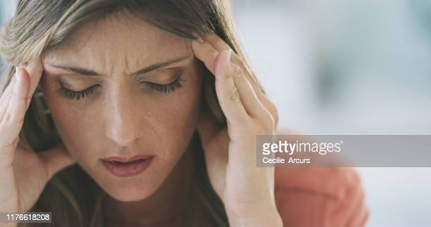 it feels like my brain is going to explode - headache stock pictures, royalty-free photos & images