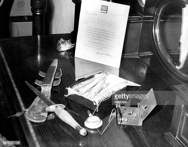 It includes a dagger a box of 'time pencil' explosives a railway detonator a threeinch booby trap and a letter of commendation from King George VI