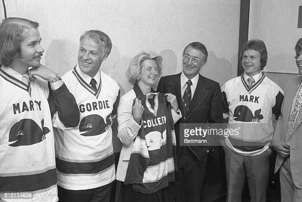 It is a family affair as hockey great Gordie Howe his wife Colleen and sons Marty and Mark try on new jerseys under the eye of Jack Kelly New England...