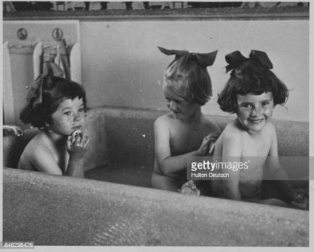 It is bathtime for pupils of Detford's Rachel McMillan Training College attending the school's summer residence at Wrotham The school educates...