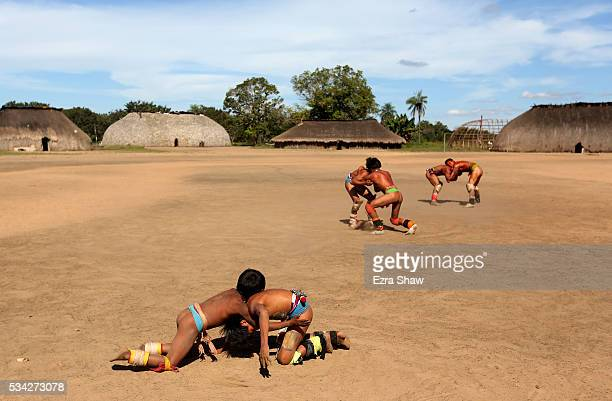 It is common for many different wrestling matches to be going on at the same time on May 8 in the village of Kamayura Brazil Boys and men of all ages...