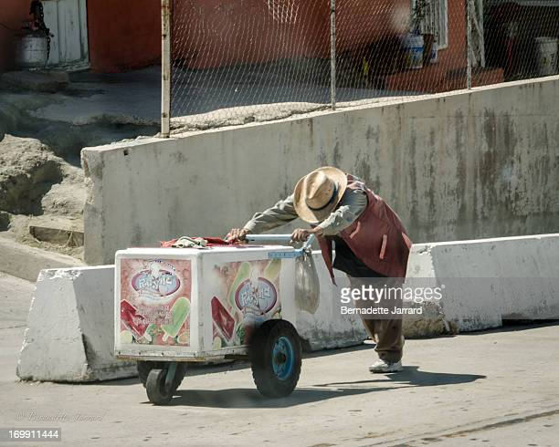 It is heartbreaking to see this hard working elderly Mexican vendor struggling to push this ice-cream cart up this steep hill near the U.S. Border...