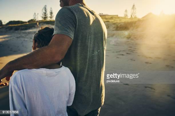 it is important to have father and son time - arm around stock pictures, royalty-free photos & images