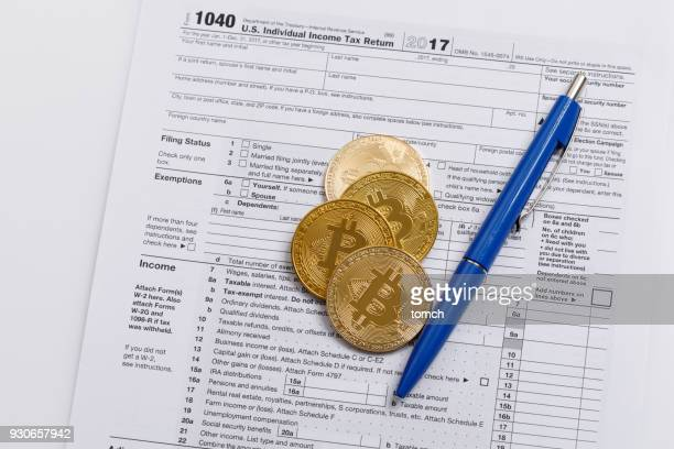 it is necessary to correctly deposit crypto-currencies in the tax return - 1040 tax form stock photos and pictures