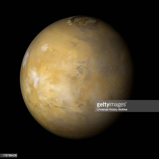It is northern summer on Mars and clouds are very common over the famous Tharsis volcanoes during the afternoon Mars Global Surveyor Orbiter