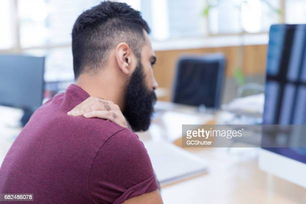 it is not easy with so much work pressure these days - clavicle stock photos and pictures