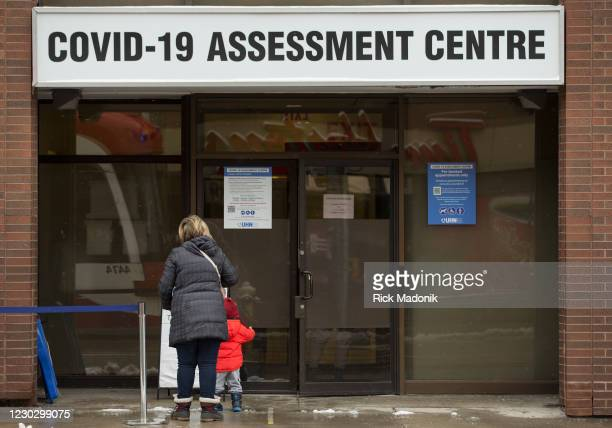 It might be Christmas Day but that hasnt stopped, or curtailed, the virus. People line up at the COVID-19 assessment centre at Toronto Western...
