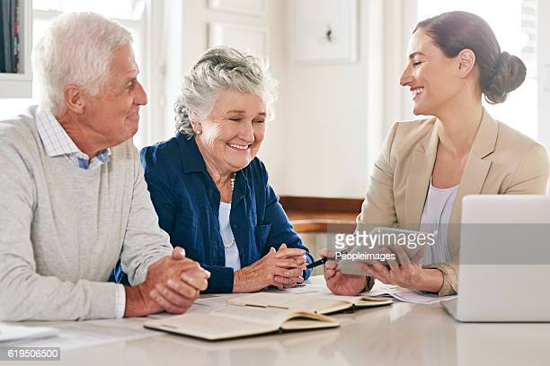 it pays to plan properly for the future - pareja hombre mayor y mujer joven fotografías e imágenes de stock