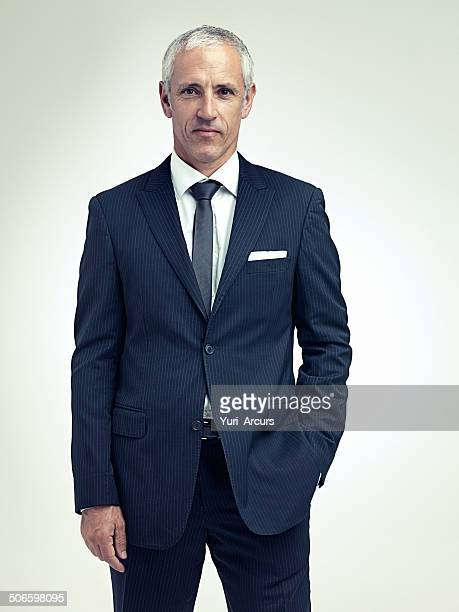 it suits him to be successful - striped suit stock pictures, royalty-free photos & images