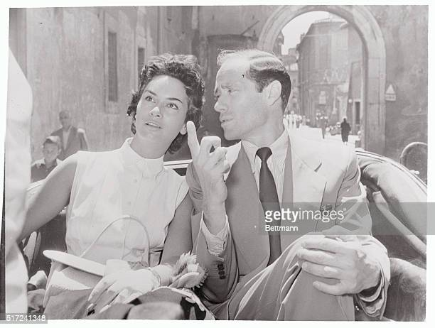 It takes an out-of-towner to show a native the sights. At least that's what U.S. Actor Mel Ferrer seems to be doing as he escorts lovely Italian...