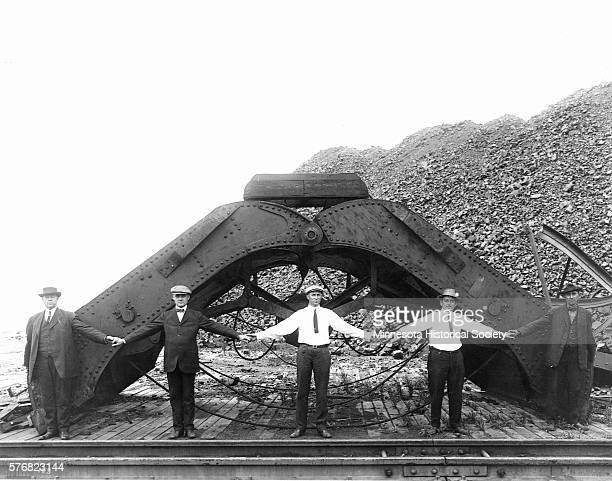 It takes the arm span of five men to equal a clamshell bucket shovel used at a Duluth coal yard