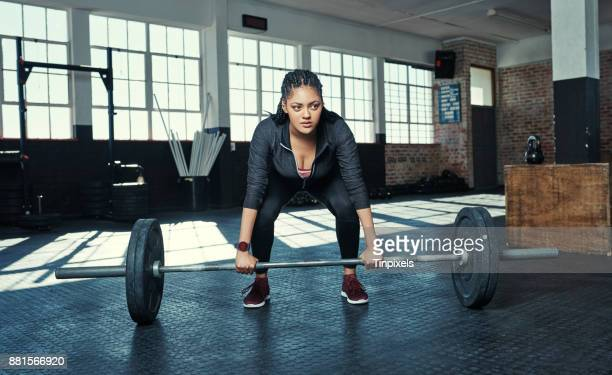 it takes time and effort to get strong - women's weightlifting stock pictures, royalty-free photos & images