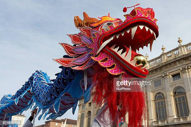 It took place on the streets of downtown Turin the Festival of the Chinese New Year 2015 Parades performing arts music and famous dance of the dragon...