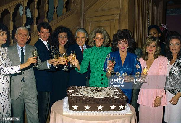 It was a big night on the set of Dynasty as the shows' cast crew partied at the send of filming of their 150th show 9/23 Toasting the events are...