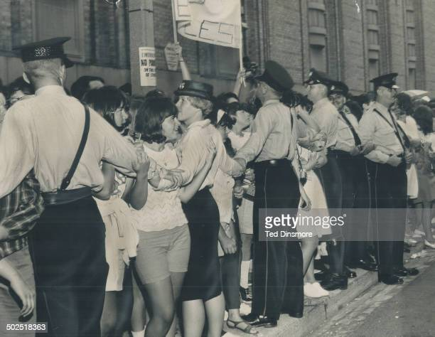 It was a hard days' night at the Gardens At Maple Leaf Gardens and at the airport Beatle fans wait patiently and otherwise to welcome their idols For...