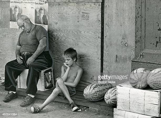 It was a hot day the kind of day one would expect to sell lots of watermelon but vendor Cosmos Neridella and his young assistant Randy Ulness both of...