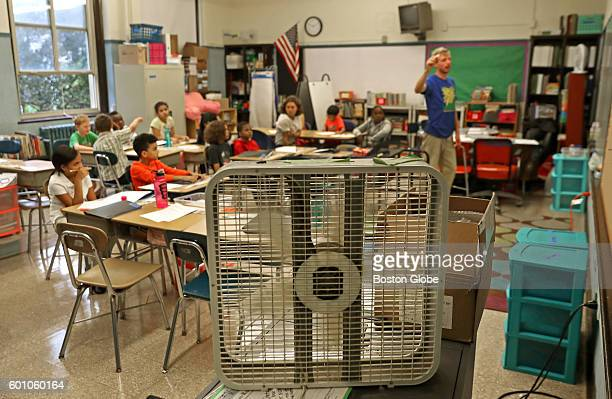 It was hot and humid on the first day of the school year at the Mary Curley K8 school in Jamaica Plain Sept 8 2016 Teacher John Barry used a fan to...