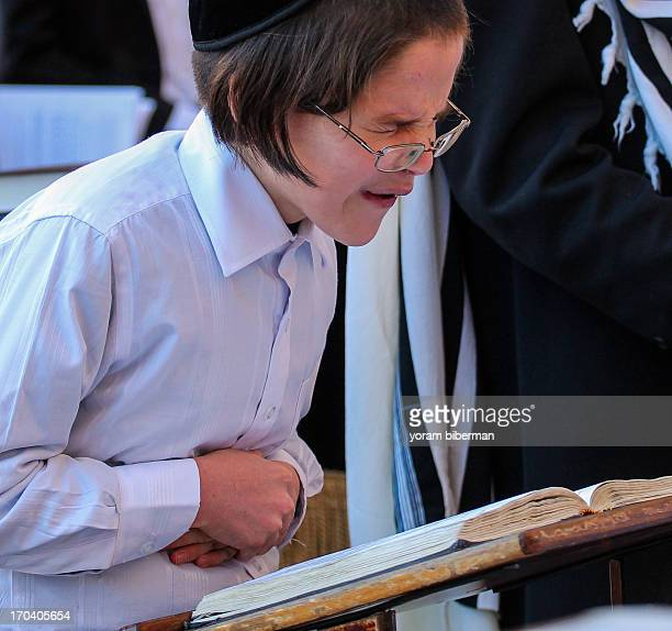 It was quiet early at the Western Wall ; the place wasn't empty, but was much less crowded then it would be a few hours later. Suddenly, this boy...