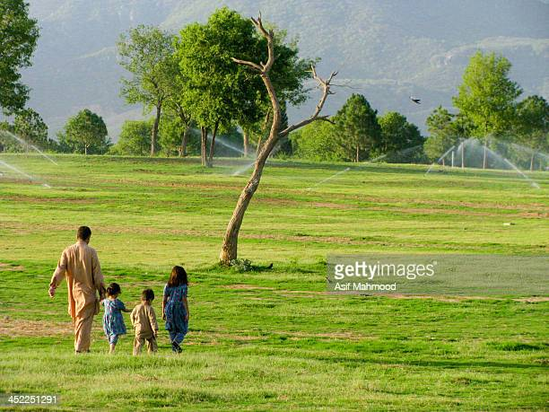 CONTENT] It was taken at Fatima Jinnah Park Islamabad There this man was walking around with his three kids