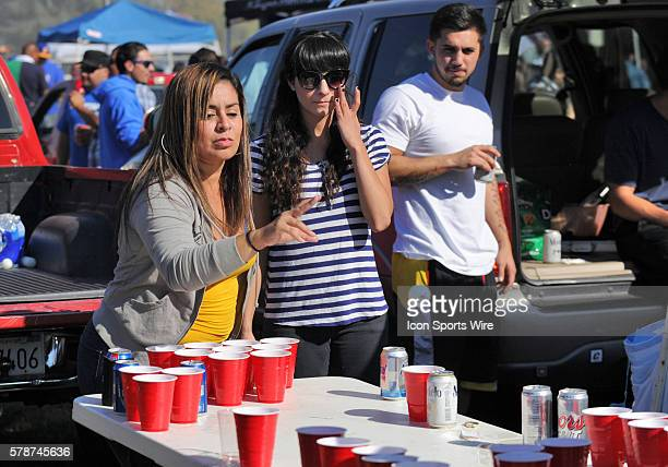 It was the girls vs the boys in a beer pong match during a tailgate party before the start of a NCAA football game between the University of Wyoming...
