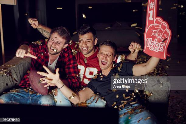 it was the most important score. debica, poland - foam finger stock photos and pictures