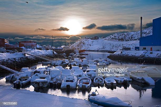It was very funny to see the snow on the boats and the sea was start to frosen. Port for small boat in Nuuk in Greenland covered with snow.