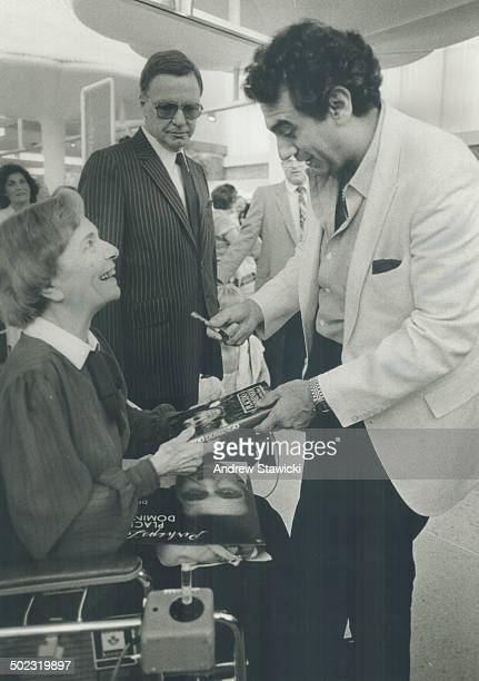 It was worth the wait The smile on Val Trollope's face says it all as opera star Placido Domingo chats with her during autograph signing session in...