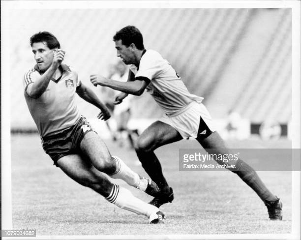 It went that awaySocceroo captain Charlie Yankos left and New Zealand striker Paul Nixon have eyes only for the ball as they turn to chase a pass...