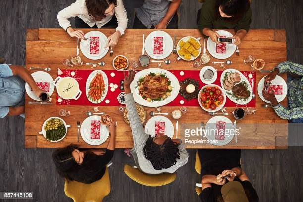 it wouldn't be a gathering without food - evening meal stock pictures, royalty-free photos & images
