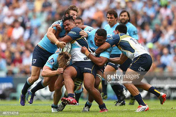Ita Vaea of the Brumbies is tackled during the round six Super Rugby match between the Waratahs and the Brumbies at Allianz Stadium on March 22 2015...