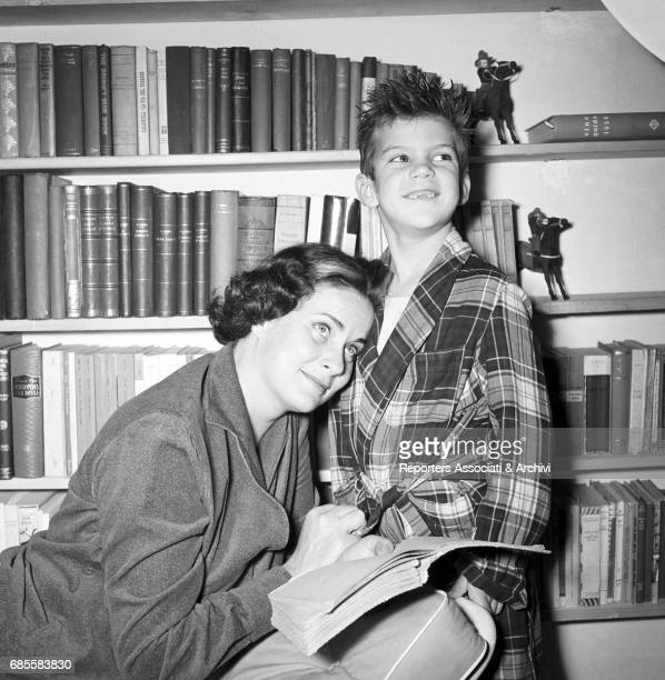 Itaian actress Alida Valli in a tender time with her younger son Larry De Mejo at home Italy 1957