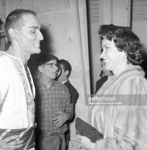 Itaiian actress Alida Valli talking and laughing with Italian actor Vittorio Gassman in the backstage of the Quirino Theatre for the premiere of...