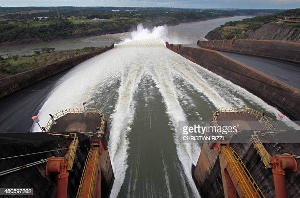Itaipu hydroelectric plant's spillway is opened in Foz do Iguacu Parana state Brazil in the border with Paraguay on July 13 after being closed for a...
