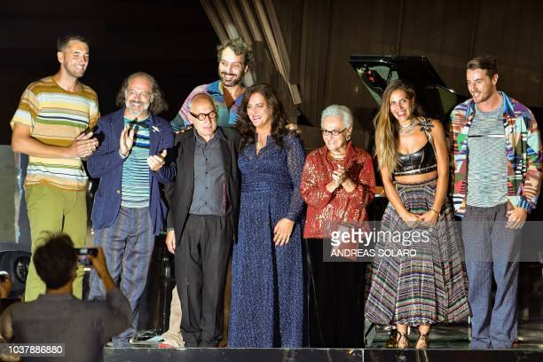 Italia fashion designer Rosita Missoni her daughter Angela Missoni her son Luca Missoni and relatives and English pianist Michael Nyman acknowledge...