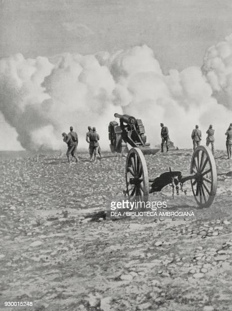 Italian 149 cannons responding to shots fired by Enver Bey's cannons Derna Libya ItalianTurkish war from L'Illustrazione Italiana Year XXXIX No 36...