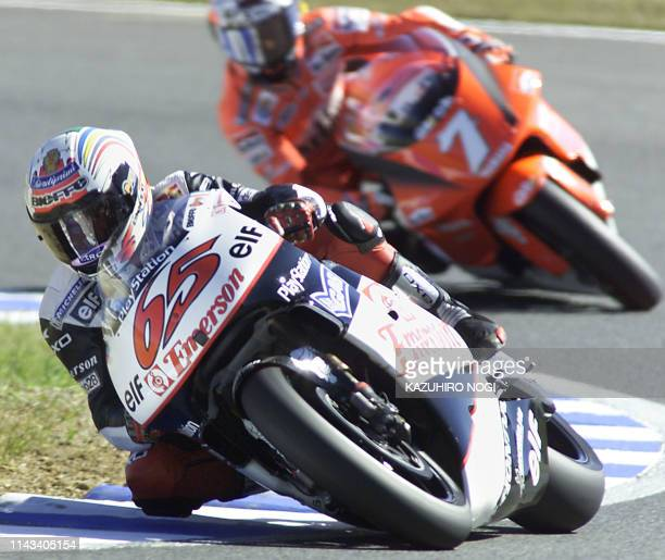 Italian 500cc motorcycle rider Loris Capirossi of Emerson Honda Pons leads Spanish Carlos Checa of Marlboro Yamaha Team during a free practice...