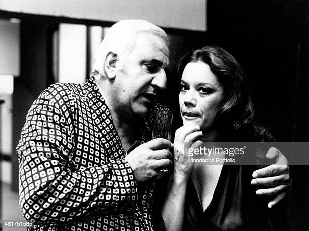 Italian actor Adolfo Celi hugging Italian actress Valeria Moriconi in the film Che notte quella notte Italy 1977