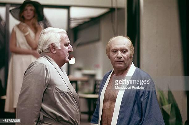 Italian actor Adolfo Celi looking at Italian actor Turi Ferro in the film Che notte quella notte Italy 1977