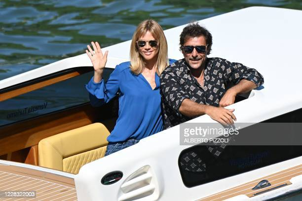 Italian actor Adriano Giannini and his wife Italian fashion designer Gaia Trussardi leave aboard a boat from the pier of the Excelsior Hotel on the...