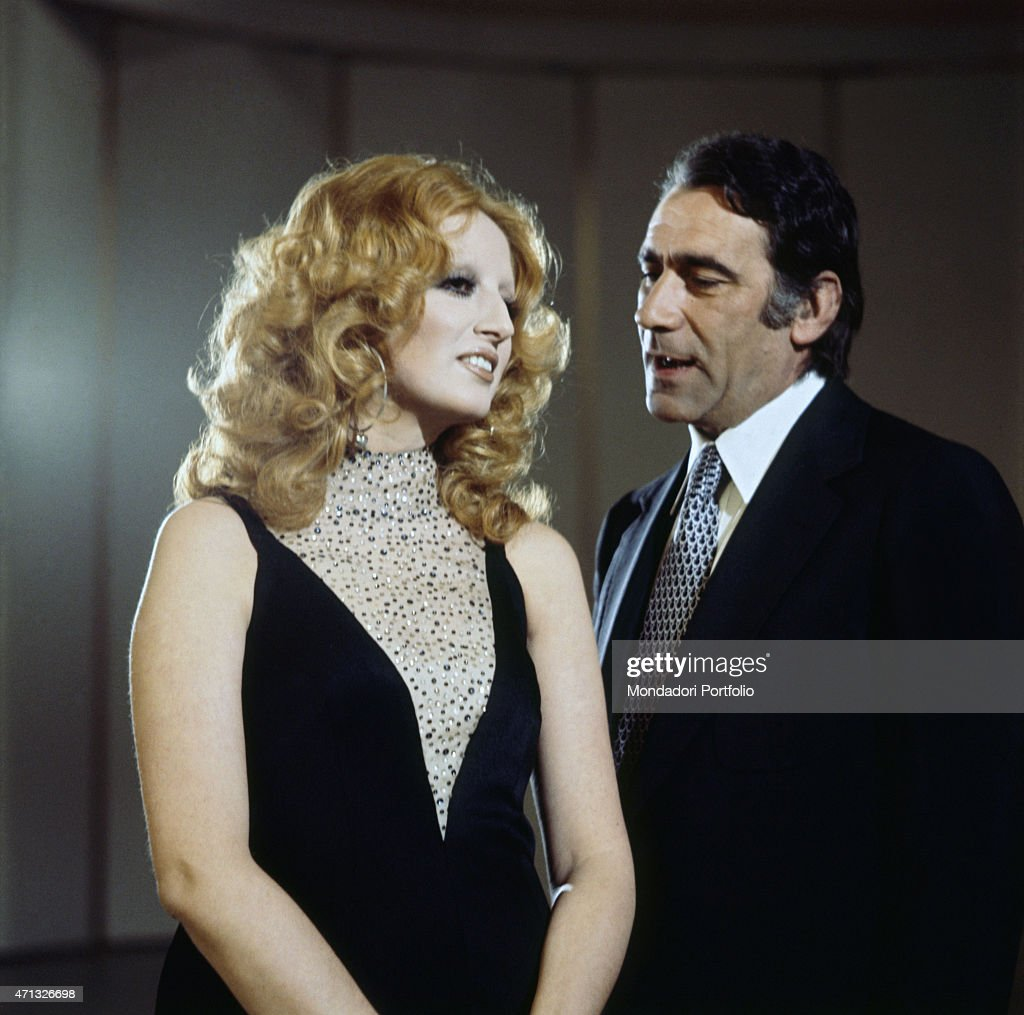 Italian Male Singers Simple alberto lupo and mina singing on teatro 10 pictures | getty images