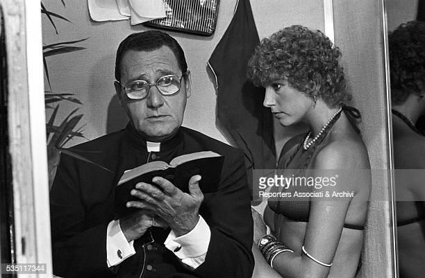 Italian actor Alberto Sordi as a monsignor and Italian actress Stefania Sandrelli in the segment L'ascensore from the film Quelle strane occasioni...